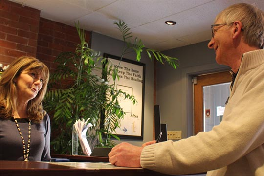 Chiropractic Peterborough ON Patient at Front Desk